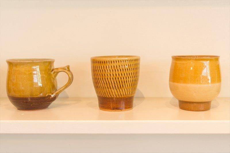 黄色がかわいい湯町窯のカップ